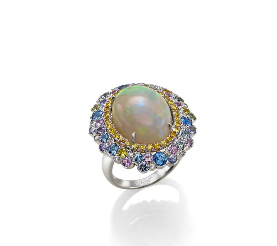 Ring in 18K white gold with Opal, yellow diamonds, aquamarines & natural sapphires